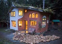Cob house at night